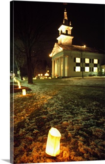 Luminaries outside small church at night, winter, Connecticut