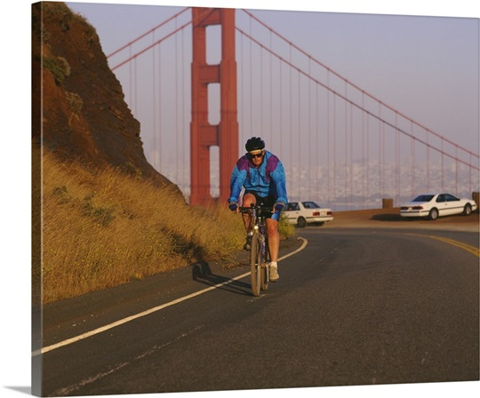 Mid adult man cycling, Golden Gate Bridge, San Francisco, California