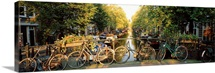 Netherlands, Amsterdam, bicycles on bridge over canal