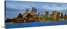 Opera house and buildings lit up at dusk Sydney Opera House Sydney Harbor Sydney New South Wales Australia
