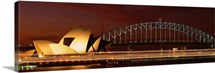 Opera house lit up at night with light streaks, Sydney Harbor Bridge, Sydney Opera House, Sydney, New South Wales, Australia