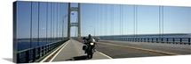 Person riding a motorcycle on a bridge Mackinac Bridge Lake Michigan Mackinaw City Michigan