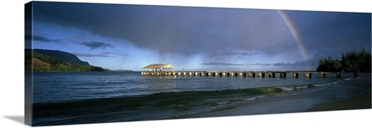Rainbow over a pier, Hanalei, Kauai, Hawaii