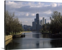 Reflection of buildings in a lagoon, Lincoln Park Lagoon, Lincoln Park, Chicago, Cook County, Illinois,