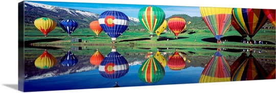 Reflection of hot air balloons on water, Colorado