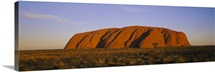 Rock formations on a landscape, Ayers Rock, Uluru-Kata Tjuta National Park, Northern Territory, Australia
