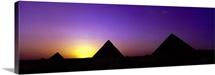 Silhouette of pyramids at dusk, Giza, Egypt