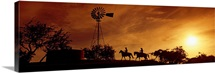 Silhouette of two horse riders at sunset, Hunt, Kerr County, Texas