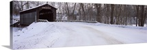 Snow covered bridge in a forest, Grand Rapids, Kent County, Michigan