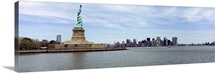 Statue Of Liberty with Manhattan skyline in the background, Ellis Island, New Jersey, New York City, New York State,