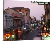 Store signs lit up at dusk, Bourbon Street, New Orleans, LA