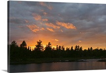 Sunset behind silhouetted forest, Lake Three, Boundary Waters Canoe Area Wilderness, Minnesota