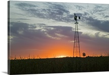 Sunset behind silhouetted windmill, Iowa