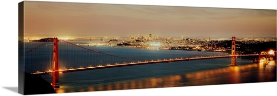 Suspension bridge lit up at dusk Golden Gate Bridge San Francisco Bay San Francisco California