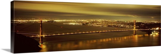 Suspension bridge lit up at dusk, Golden Gate Bridge, San Francisco, California,