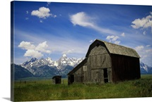 Teton Barn, distant snow-covered mountains, Grand Teton National Park, Wyoming