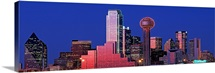Texas, Dallas, Panoramic view of an urban skyline at night