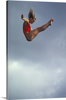 Female diver flying through the air