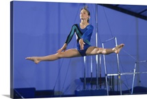 Female gymnast on the balance beam