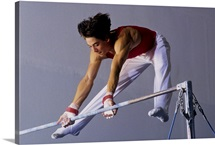 Male gymnast performing on the horizontal bar
