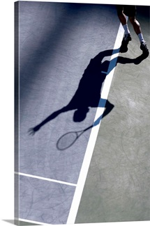 Shadow of tennis player serving