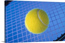 Tennis ball on racquet