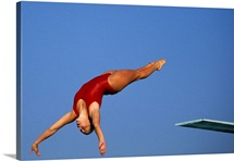 Woman diver flying through the air