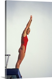 Woman diver preparing to jump off the platform