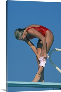 Woman preparing to dive off spingboard