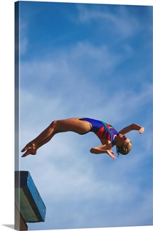 Young girl diving off the 10m platform