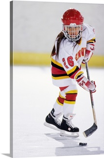 Young girl playing ice hockey