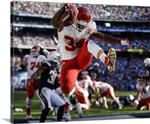 Chiefs Knile Davis jumps in the end zone as he scores touchdown, Dec. 29, 2013