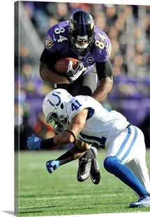 Colts Ravens Football - Ed Dickson hit by Antoine Bethea