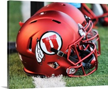 Red football helmets worn by the Utah Utes at Rice-Eccles Stadium