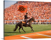 The Cowboy Enters Boone Pickens Stadium