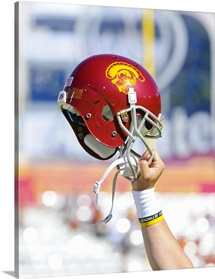 Trojans Helmet Held Up