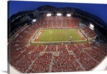 Utah and Utah State players gather on the field at Utah's Rice-Eccles Stadium