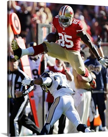 Vernon Davis jumps over Rodney McLeod, 49ers and Rams game, Dec. 1, 2013