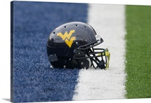 WVU Football Helmet sits at Milan Puskar Stadium