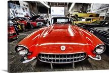 Classic red corvette in a car repair shop