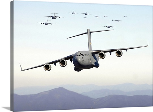 A formation of 17 C17 Globemaster IIIs fly over the Blue Ridge Mountains