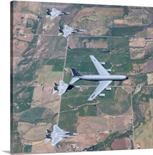 A KC-135R Stratotanker refuels four F-15 Eagles over Oregon