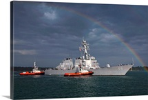 A rainbow arches over the guided missile destroyer USS Gonzalez