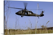 A US Army UH60 Black Hawk helicopter prepares to pick up soldiers