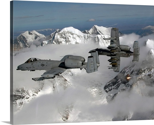 A10 Thunderbolt IIs fly over mountainous landscape
