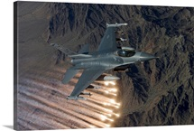 An F-16 Fighting Falcon releases flares during a training mission