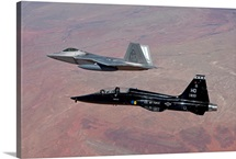 An F-22 Raptor and a T-38 Talon fly in formation over New Mexico
