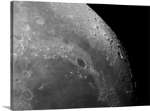 Close up view of the moon showing impact crater Plato