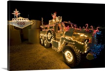 Cougar MRAP is adorned in holiday lights parked in front of EOD Iraq