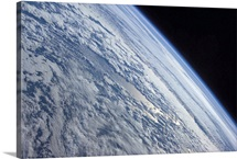 Earths horizon against the blackness of space